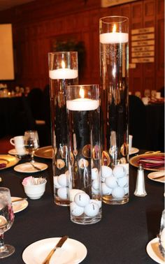 Centerpiece idea for a Charity Pro Am event or Golf Tournament Awards Banquet or Dinner, glass cylinders with golf balls placed in the bottom, filled with water, and floating candles on top. Golf balls could also have the event logo or sponsor logo. Golf Centerpieces, Golf Party Decorations, Table Decorations, Centerpiece Ideas, Centrepieces, Golf Design, Thema Golf, Golf Wedding, Wedding Decor
