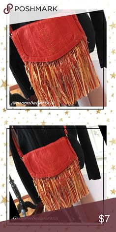 🐝🦋💕Fringed and Frayed cross body purse 🦋💕🐝 Brunt orange cross body bag. Fringed and frayed makes this Mossimo bag super fun!  Same color lining inside with one zippered pocket and two additional pockets for eyeglasses or cellphone. No holes rips or tears. Good condition. Bags Shoulder Bags