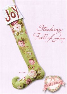 """Stocking Full of Joy Kit: Elves need stockings, too!  This whimsical design was created with Roses de Noel fabrics from Robyn Pandolph.  Kit includes pattern and all fabrics.  Stocking finishes to 6"""" x 24""""."""