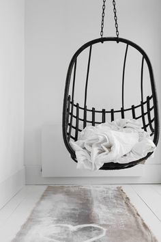 Dutch Interior Designer Natasja Molenaar's  bedroom in Haarlem !!! Foto by Marjon hoogervorst and styling bij Anoukb I certainly want one of these hanging chairs for a weekend getaway...