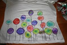 Solubility - rubber band sections of shirt over cup, make small circles with colored sharpie marker, drip rubbing alcohol on it (water first - it does not work), colors spread out because it is soluble in alcohol.  Do this all over shirt, but let dry completely each time.  After finished, add any extra drawing you want.  Dry on high heat 15 min.