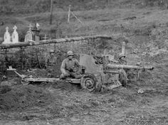 Gunners of the 44th Infantry Division US position with a 57 mm anti-tank gun British M1 (QF 6 pounder) near the city of Setal (Siersthal), France.