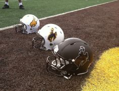 The three main styles of Wyoming Cowboy football helmets. American Football, Wyoming Cowboys Football, College Football Uniforms, Go Pokes, Sports Art, A Team, All About Time, Wicked, Basketball