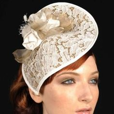 Mistress Lace    A teardrop of sinamay is beautifully covered in lace and finished with a silk rose. Designed and shaped to mould around your face, this is a beautifully light headpiece. Mistress Lace is perfect for a summer wedding, secured by a delicate Alice band.