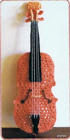 I really like this crochet violin, crochet music instruments are a really neat idea.