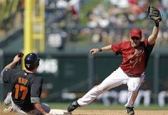Arizona Diamondbacks shortstop Willie Bloomquist, right, forces out San Francisco Giants' Aubrey Huff at second base after a ground ball by Gregor Blanco during the sixth inning of a spring training baseball game Tuesday, March 20, 2012 in Scottsdale, Ariz. (AP Photo/Marcio Jose Sanchez)