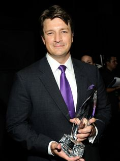 Nathan Fillion Smiles After Accepting His People's Choice Award on January 11, 2012