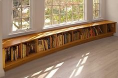 I saw an apartment with a tiny sun room. I want, no NEED a bookshelf bench in a sun room.
