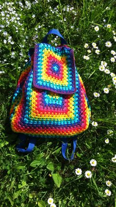 crochet backpack/ like the use of grannies, but do NOT like the use of the rainbow colours.
