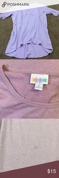Light purple LULAROE Irma Solid light purple LULAROE Irma. Has a tiny stain on the front which isn't really noticeable when wearing (Price reflects this) the last photo against the Leggings (you can find the leggings for sale in my closet) is the best coloring shot I could get. Washed per LULAROE instructions. Smoke free home LuLaRoe Tops Tees - Short Sleeve