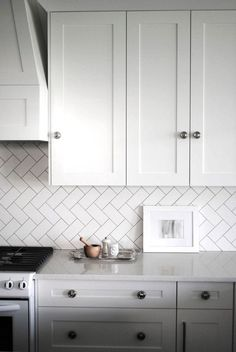 Herringbone Subway Tile Backsplash - Design photos, ideas and inspiration. Amazing gallery of interior design and decorating ideas of Herringbone Subway Tile Backsplash in bathrooms, kitchens by elite interior designers. Kitchen Redo, Kitchen Tiles, New Kitchen, Kitchen Remodel, White Kitchen Backsplash, Shaker Kitchen, Kitchen White, Glass Kitchen, Kitch Backsplash Ideas