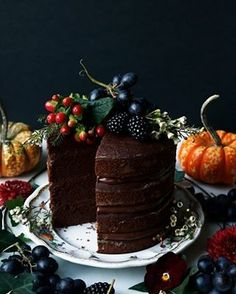 Pumpkin Chocolate Layer Cake (vegan & gluten-free) Wholesome moist gluten-free vegan four layer cake filled with chocolate ganache topped with festive fruit and flowers. Salted Caramel Chocolate Cake, Chocolate Caramels, Vegan Chocolate, Chocolate Ganache, Chocolate Sponge, Chocolate Cheesecake, Chocolate Truffles, Vegan Sweets, Vegan Desserts