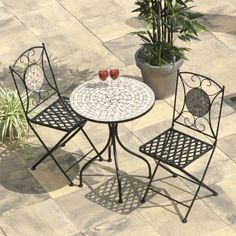 Selima Mosaic Cast Iron Bistro Set Bistro table set for the small balcony Outdoor Furniture, Bistro Set, Bistro Table Set, Mosaic Table, Round Garden Table, Garden Furniture Sets, Outdoor Patio Decor, Garden Dining Set, Garden Furniture
