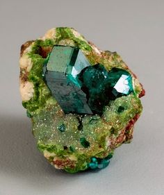 Dioptase on Duftite and Calcite: from the Tsumeb Mine, Otjikoto Region, Tsumeb, Namibia. A grass green matrix of duftite and calcite is host to a 12 mm tall dioptase crystal. Minerals And Gemstones, Rocks And Minerals, Beaded Beads, Beautiful Rocks, Beautiful Things, Rock Collection, Mineral Stone, Rocks And Gems, To Infinity And Beyond