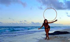 Bermuda Hooping with Ish. Ishrat Yakub spins up a truly beautiful photo while hooping on the beaches of Bermuda. Photo by Chris Ingham.