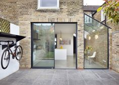 Rise Design Studio adds glass extension to London house Rise Design Studio has added a glazed extension to the rear of a London house, creating a light-filled kitchen and dining room that opens up to the garden House Extension Design, Extension Designs, Glass Extension, Side Extension, Extension Ideas, Porch Extension, Exterior Design, Interior And Exterior, Exterior Tiles