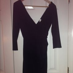 NWT White House Black Market Black Dress This listing is for a brand new with tags WMBH dress. It is ruched at the waist on the left for a flattering fit. Marked a size 4 but fits 4-6. (I put the dress on in the last photo to show length- clearly I am a size 8 now so please be nice that it doesn't fit me!) White House Black Market Dresses Long Sleeve