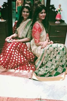 Green half saree and red blouse with muggu design by Kavitha Gutta