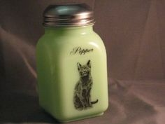Green Milk Glass Pepper Spice Shaker with Caz the Cat Logo by Mossopeddler. $17.99. Fired On Decals for Long Lasting. American Made Glassware. Great mixing bowls. Timeless Sitting Cat Theme. Very charming cottage theme. See our entire line of Jade green milk glass, Jadeite, hand made in America. This is a must for the cat lovers in all of us.   Be sure to collect the entire set. We call this our Cazzabella line.  Named for our wonderful russian blue looking ca...