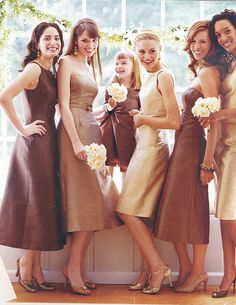be65b544181 Mis-matched bridesmaids in brown and tan dresses with white flowers. Cream  Bridesmaids