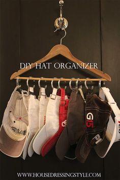 hanger + shower curtain rings = hat organizer
