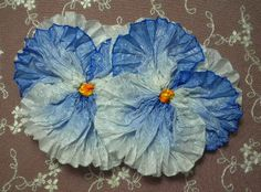 Giant Blue And White Pansy Ribbon Flower Applique.  via Etsy.