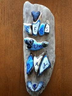 SEAS THE DAY out of small driftwood pieces and Alaskan shells/beach glass