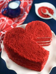 Yummy red velvet cake with cream cheese frosting is perfect to express your heart's love. This cake gets its heart shape from a hand-drawn template and serrated knife — no specialty pans required here.