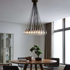 The Gambit 19-Lite LED multiport chandelier family exudes undeniable beauty and warm contemporary style through its bold use of high end mixed materials and retro-inspired, fully dimmable LED lamping.