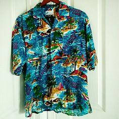 Vintage Hawaiian Shirt Size L Really cool bright blue hawaiian shirt with treasure island print and wooden looking buttons. 100% Rayon. Super comfortable! Tops Button Down Shirts