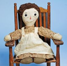 """P. F. VOLLAND'S EARLIEST RAGGEDY ANN - PATENTED 1915 CLOTH DOLL. Marks: Patented Sept. 7, 1915. 16"""". All-cloth doll with flat face, black shoe-button eyes on painted eye whites, painted brown eyebrows, and lower eyelashes, black outlined red nose, gently-smiling wide painted mouth, brown worsted wool hair, stitch-jointed body with heart inside cloth front torso, sewn-on red and white striped stockings with brown sewn-on shoes."""