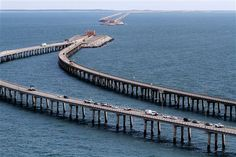 Chesapeake Bay Bridge-Tunnel - connecting the Delmarva Peninsula with Virginia;  23 miles of combined bridges and tunnels, crossing two major shipping lanes and uses four artificial islands as portals;  the two 1-mile tunnels of the CBBT go under major shipping lanes      - AP Photo/The Virginian-Pilot, Hyunsoo Leo Kim