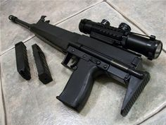 Grendel R31. It is a semi-automatic carbine that is chambered in .22 Winchester Magnum