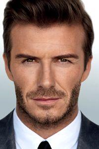 Man up! David Beckham goes topless in an ad for his new 'masculine' fragrance Homme James Franco, Dolce & Gabbana, David Beckham, Giorgio Armani, Bugatti, Yves Saint Laurent, Flavio, Charming Man, Ralph Lauren