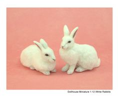 White rabbit sculpts of clay & fiber by Kerri Pajutee