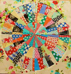 Not the prettiest fabric, but cool way to make this radial quilt with freezer paper