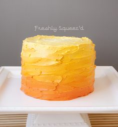 A yellow and orange ombre smash cake for Archers first birthday.
