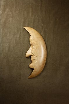 A Wood Carving of a Moon Man makes a Great 5th Wood Wedding Anniversary Gift for your Husband or Wife. I am Gary Burns the Treewiz and I