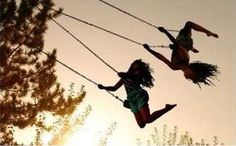 Cute picture for best friends or sisters with just dark shadows of the subjects in the sunset.