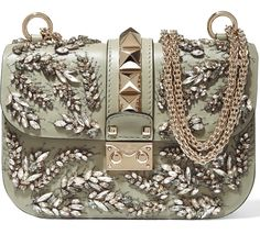 Of all the adornments and finishes a bag can have, chain straps are one of the more controversial when it comes to our readers. Some of you love the look, but many of you complain that the straps are uncomfortable, snag your hair or leave marks on your shoulders. For the latter group, we have …
