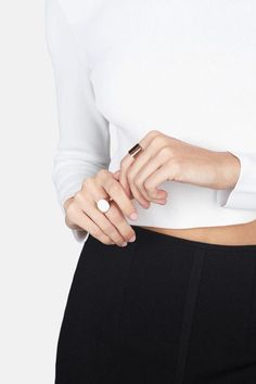 Simple rings and monochrome styling. Minimalist accessories inspiration.