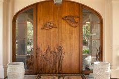 Image from http://yacineaziz.com/wp-content/uploads/2015/04/Chic-Doormat-mode-San-Diego-Traditional-Entry-Inspiration-with-arched-doorway-carved-wood-door-mat-doormat-ducks-monogram-sidelites-stucco-tall-grasses-urns.jpg.