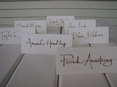wedding calligraphy place card, escort card, name card, table card. $1.00, via Etsy.