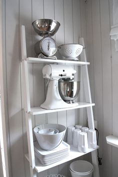 Lovely shelves- we already have some and they are great! Could be easy to DIY with old ladders or just some loose wood planks