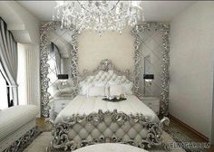 Ornate white & silver bedroom.                                                                                                                                                      More
