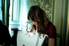 Alexa Chung appears in Longchamp's new campaign for its Le Pliage Héritage bag - with a little friend in tow.