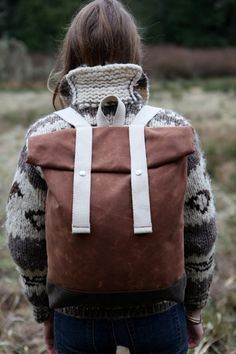 Cowichan style knit sweater and rucksack.