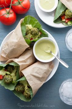 Raw Falafel Wraps with Parsley Tahini Sauce // collards leaf wraps, cucumber,tomatoes, tahini parsley sauce, pistachio-sesame falafel