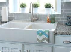 Ikea apron-front sink. $349. I like the cabinets, backsplash, and countertops too!