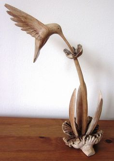 wooden hummingbird sculpture